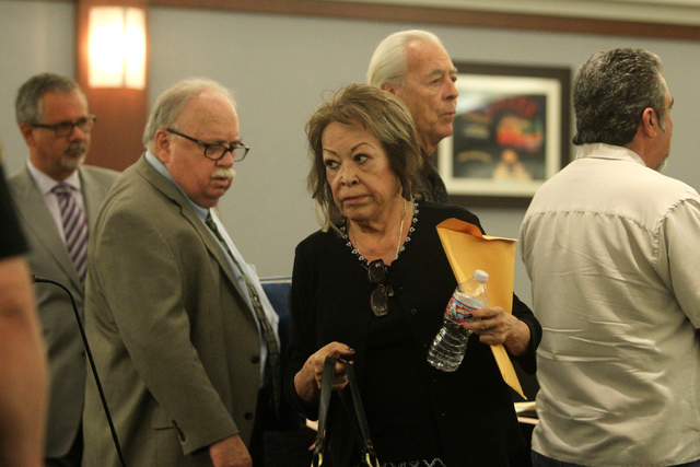 Priscilla Rocha, center, exits Judge Susan Johnson's courtroom at the Regional Justice Center on Tuesday, June 30, 2015, in Las Vegas. Rocha plead guilty to stealing hundreds of thousands of dolla ...
