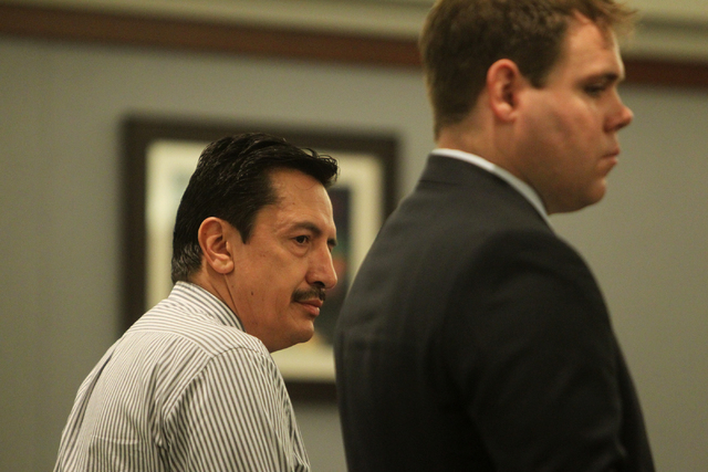 Andres Mendoza, left, listens to Judge Susan Johnson at the Regional Justice Center on Tuesday, June 30, 2015, in Las Vegas. Rocha plead guilty to stealing hundreds of thousands of dollars from th ...
