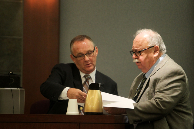Financial investigator with the Las Vegas Metro Police Department Colin Haynes, left, speaks with attorney Tom Pitaro at the Regional Justice Center on Tuesday, June 30, 2015, in Las Vegas. Rocha  ...