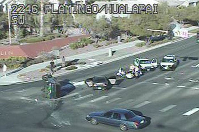 Las Vegas police respond to a rollover accident at Flamingo Road and Hualapai Way in Las Vegas on Wednesday, June 17, 2015. (Courtesy/RTC FAST Cameras)