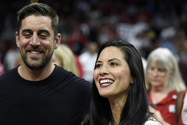 Mar 28, 2015; Los Angeles, CA, USA; Green Bay Packers quarterback Aaron Rodgers and film actress Olivia Munn in attendance during the 85-78 Wisconsin Badgers victory against Arizona Wildcats in th ...