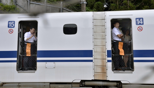 Passengers are seen inside a Shinkansen bullet train after it made an emergency stop in Odawara, south of Tokyo, in this photo taken by Kyodo June 30, 2015. A Japanese Shinkansen bullet train made ...