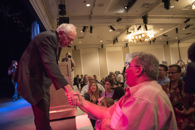U.S. Sen. Bernie Sanders, left, shakes hands with a supporter after speaking at Treasure Island hotel-casino in Las Vegas on Friday, June 19, 2015. Sanders is an independent from Vermont who is se ...