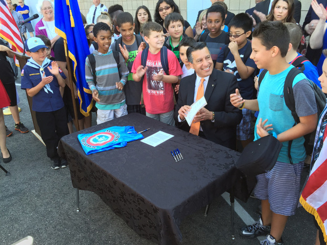 Gov. Brian Sandoval smiles Wednesday after signing Senate Bill 391 -- the Read by Three bill -- at Rogers Elementary School.