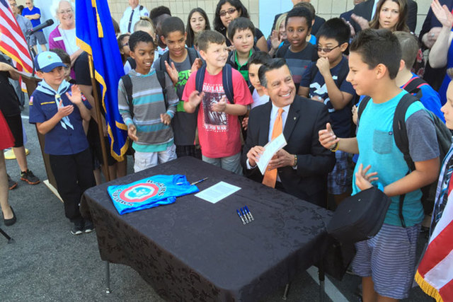 Gov. Brian Sandoval smiles after signing Senate Bill 391 -- the Read by Three bill -- at Rogers Elementary School on June 3, 2015. (Las Vegas Review Journal)