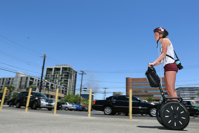 Ashley Smith, of Springfield, Ill., practices riding a Segway before participating in an hour-long tour of downtown with Segway Las Vegas Tuesday, June 16, 2015, in Las Vegas. Segway Las Vegas off ...