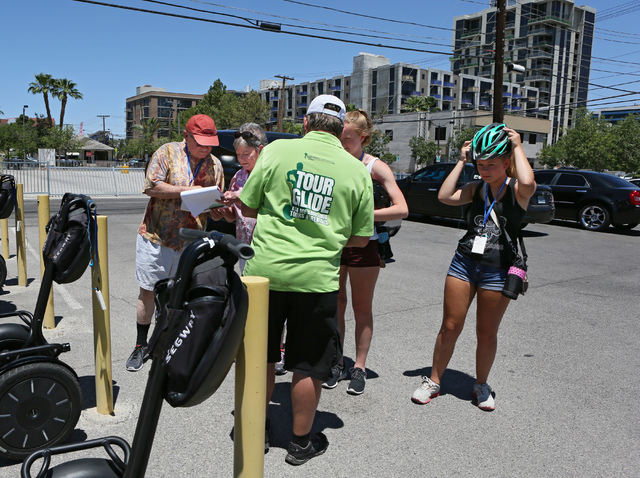 A family prepares to participate in a tour of downtown Las Vegas led by Scott Milheiser, center, with Segway Las Vegas Tuesday, June 16, 2015. Segway Las Vegas offers instruction and guided tours  ...