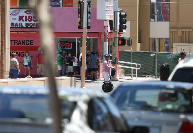 Carlyne Meyer, of Springfield, Ill., rides a Segway along Las Vegas Boulevard during a group tour of downtown with Segway Las Vegas Tuesday, June 16, 2015, in Las Vegas. Segway Las Vegas offers in ...