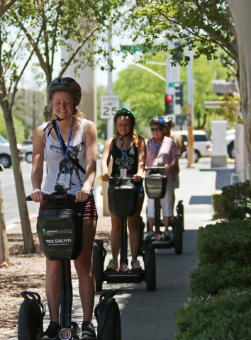 Ashley Smith, from left, Katie Smith and Carlyne Meyer ride Segways during a group tour of downtown with Segway Las Vegas Tuesday, June 16, 2015, in Las Vegas. Segway Las Vegas offers instruction  ...
