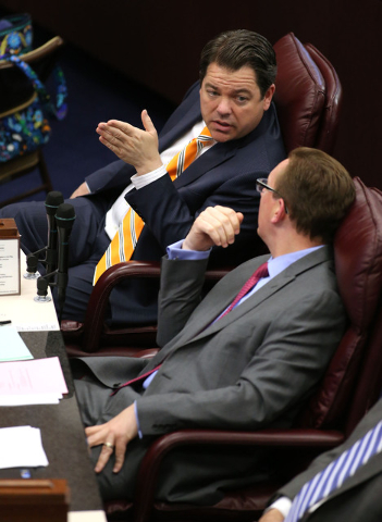 Nevada Senate Republicans Michael Roberson and Ben Kieckhefer work on the Senate floor in the final hours of the session at the Legislative Building in Carson City, Nev., on Monday, June 1, 2015.  ...