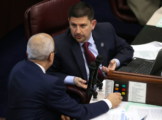 Nevada Senate Democrats Mo Denis, left, and Mark Manendo work on the Senate floor in the final hours of the session at the Legislative Building in Carson City, Nev., on Monday, June 1, 2015. (Cath ...