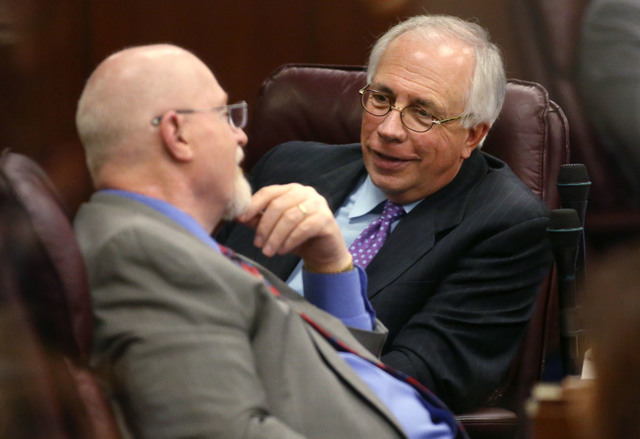 Nevada Assembly Republicans Randy Kirner, left, and Pat Hickey talk on the Assembly floor in the final hours of the session at the Legislative Building in Carson City, Nev., on Monday, June 1, 201 ...