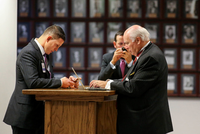 Lobbyists, from left, Joey Gilbert, Nick Vander Poel and Sam McMullen work in the final hours of the session at the Legislative Building in Carson City, Nev., on Monday, June 1, 2015. (Cathleen Al ...