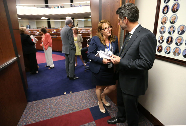 Nevada Assembly Minority Leader Marilyn Kirkpatrick, D-North Las Vegas, talks with lobbyist Michael Alonso in the final hours of the session at the Legislative Building in Carson City, Nev., on Mo ...