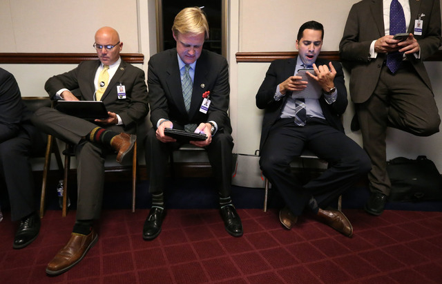 Lobbyists work the final minutes of the legislative session at the Legislative Building in Carson City, Nev., on Monday, June 1, 2015. (Cathleen Allison/Las Vegas Review-Journal)