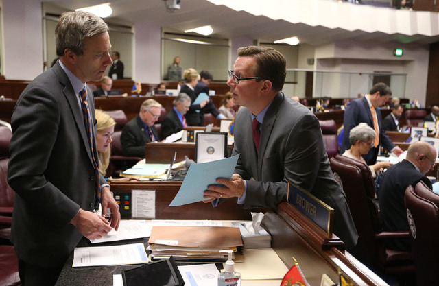 Nevada Senate Republicans Greg Brower, left, and Ben Kieckhefer work on the Senate floor in the final minutes of the legislative session at the Legislative Building in Carson City, Nev., on Monday ...