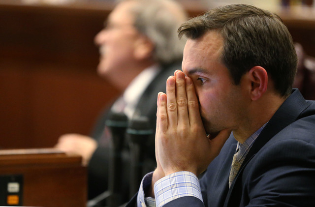 Nevada Assemblyman Derek Armstrong, R-Henderson, works on the Assembly floor in the final minutes of the session at the Legislative Building in Carson City, Nev., on Monday, June 1, 2015. (Cathlee ...