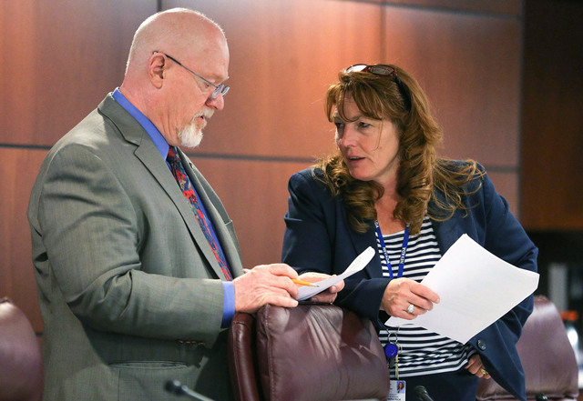Nevada Assemblyman Randy Kirner, R-Reno, and Minority Leader Marilyn Kirkpatrick, D-North Las Vegas, work in a committee meeting in the final hours of the Legislative session in Carson City, Nev., ...