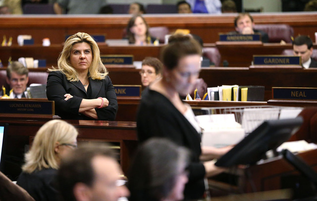 Nevada Assemblywoman Michele Fiore, R-Las Vegas, watches the final chaotic minutes of the session tick down at the Legislative Building in Carson City, Nev., on Monday, June 1, 2015. (Cathleen All ...