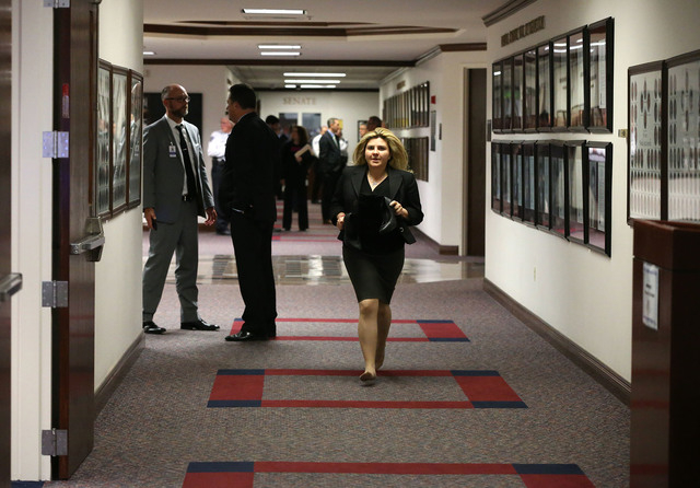 Nevada Assemblywoman Michele Fiore, R-Las Vegas, runs between chambers to help get a bill processed as the final chaotic minutes of the session tick down at the Legislative Building in Carson City ...