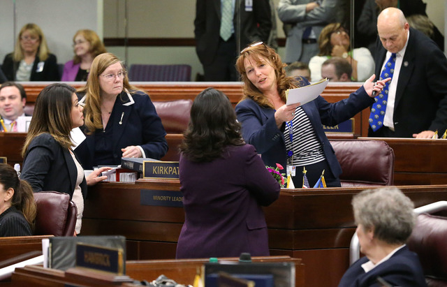 Nevada Assembly Democrats, from left, Teresa Benitez Thompson, Maggie Carlton, Irene Bustamante Adams and Marilyn Kirkpatrick talk on the Assembly floor in the final chaotic minutes of the session ...