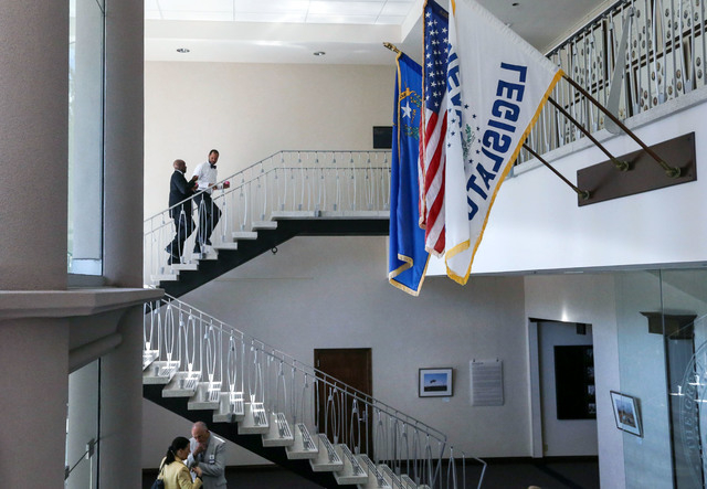 Nevada Senate Democrats Kelvin Atkinson, top left, and Aaron Ford work in the final hours of the session at the Legislative Building in Carson City, Nev., on Monday, June 1, 2015. (Cathleen Alliso ...