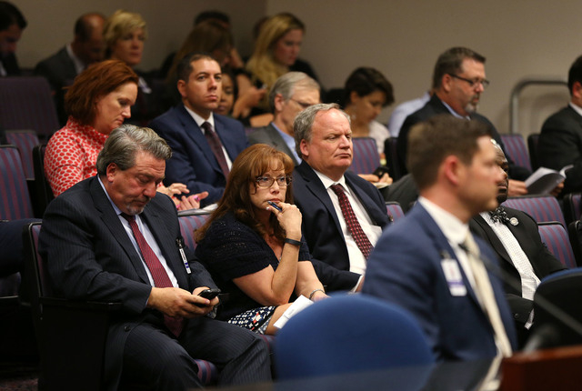 Hundreds of lobbyists and other spectators listen to hearings as lawmakers rush to meet their midnight deadline at the Legislative Building in Carson City, Nev., on Monday, June 1, 2015. (Cathleen ...
