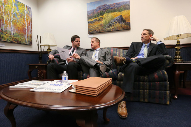 Lt. Gov. Mark Hutchison, center, and his chief of staff Ryan Cherry, left, talk with Sen. Scott Hammond, R-Las Vegas, in the final hours of the session at the Legislative Building in Carson City,  ...