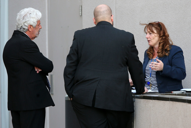 Nevada Assembly Minority Leader Marilyn Kirkpatrick, D-North Las Vegas, talks with lobbyist Billy Vassiliadis, left, during a break in the final hours of the session at the Legislative Building in ...