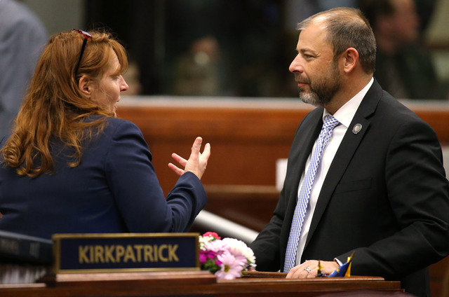 Nevada Assembly leaders Marilyn Kirkpatrick, D-North Las Vegas, and Paul Anderson, R-Las Vegas, work in the final hours of the session at the Legislative Building in Carson City, Nev., on Monday,  ...