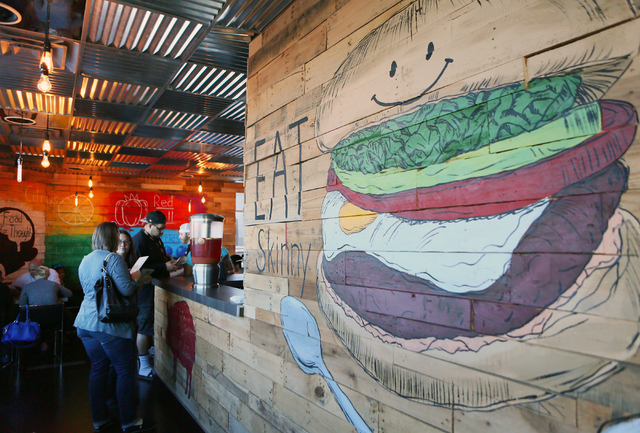 Customers wait at the counter near a mural at SkinnyFats Saturday, Dec. 6, 2014, in Las Vegas.  (Ronda Churchill/Las Vegas Review-Journal)