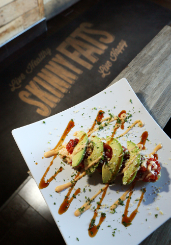 Spicy ahi with sriracha slaw in a cucumber boat with almonds, teriyaki, avocado and sriracha aioli is shown at SkinnyFATS Saturday, Dec. 6, 2014, in Las Vegas. (Ronda Churchill/Las Vegas Review-Jo ...