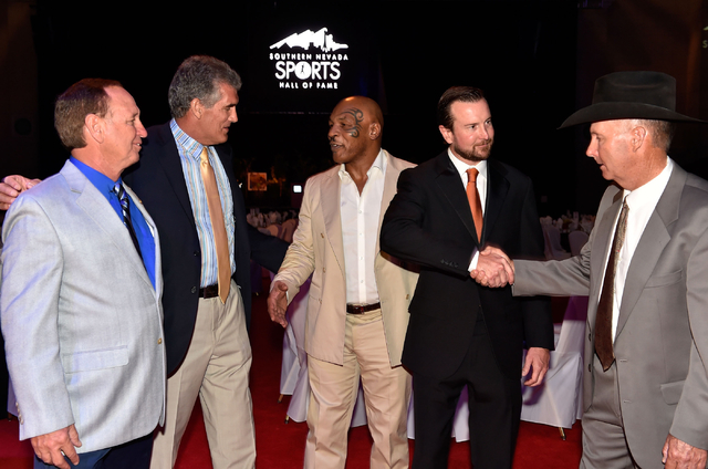 Inductees from left, former golf pro Joe Kelly, retired NFL quarterback Glenn Carano, former boxer Mike Tyson, NASCAR driver Kurt Busch and rodeo coach Ric Griffth appear at the Southern Nevada Sp ...