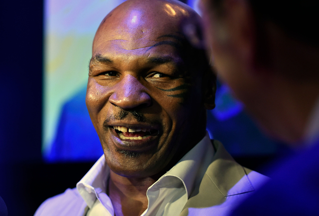 Retired boxer Mike Tyson appears at the Southern Nevada Sports Hall of Fame induction event at the Orleans Arena on Friday, June 19, 2015, in Las Vegas. (David Becker/Las Vegas Review-Journal)