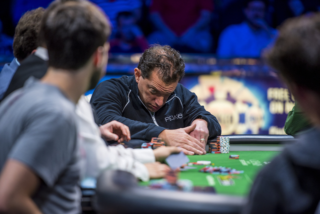 Dan Perper checks his cards during the One Drop High Roller final table at the World Series of Poker at the Rio Convention Center in Las Vegas on Monday, June 29, 2015. (Joshua Dahl/Las Vegas Revi ...