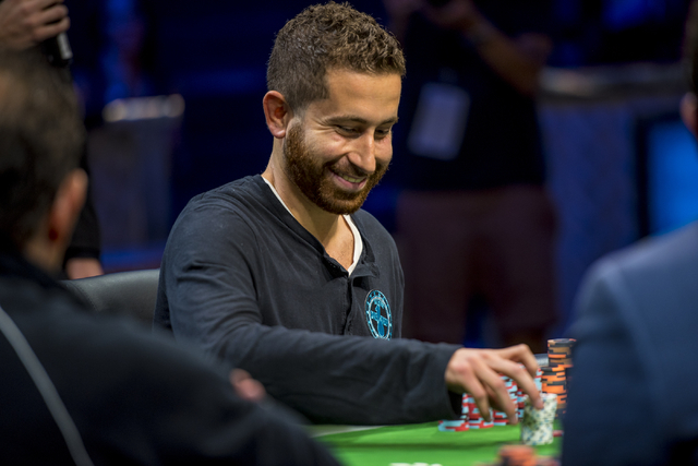 Jonathan Duhamel smiles after winning a hand during the One Drop High Roller final table at the World Series of Poker at the Rio Convention Center in Las Vegas on Monday, June 29, 2015. (Joshua Da ...