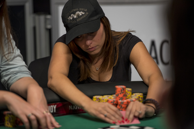 Amanda Sizemore checks her cards during the final table of the Ladies Championship at the World Series of Poker at the Rio Convention Center in Las Vegas on Sunday, June 28, 2015. (Joshua Dahl/Las ...