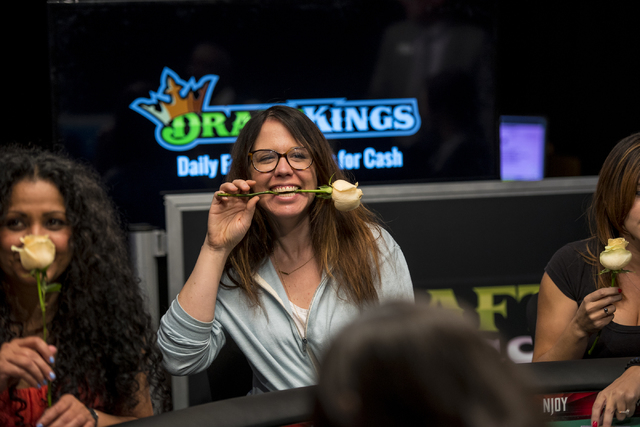 Hope Williams holds a rose in her teeth during the final table of the Ladies Championship at the World Series of Poker at the Rio Convention Center in Las Vegas on Sunday, June 28, 2015. (Joshua D ...