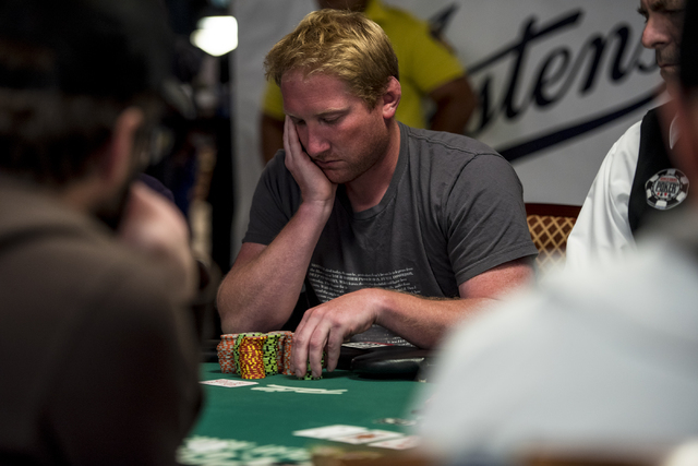 """Joshua Wallace looks down at his chips during the World Series of Poker's $1,500 buy-in """"Monster Stack"""" tournament held at the Rio Convention Center in Las Vegas on Tuesday, June 16, 201 ..."""