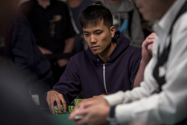 """Kevin Kung looks on as cards are dealt during the World Series of Poker's $1,500 buy-in """"Monster Stack"""" tournament held at the Rio Convention Center in Las Vegas on Tuesday, June 16, 201 ..."""