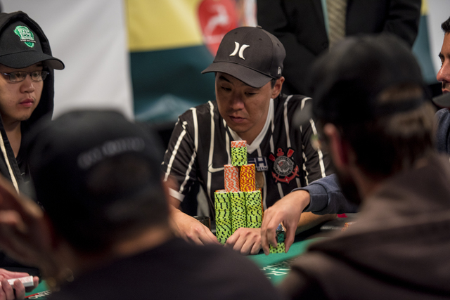 """Fernando Konishi surveys the table during the World Series of Poker's $1,500 buy-in """"Monster Stack"""" tournament held at the Rio Convention Center in Las Vegas on Tuesday, June 16, 2015. ( ..."""