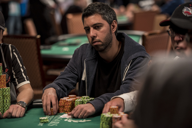 """Asi Moshe looks across the table during the World Series of Poker's $1,500 buy-in """"Monster Stack"""" tournament held at the Rio Convention Center in Las Vegas on Tuesday, June 16, 2015. (Jo ..."""