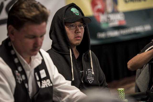 """Perry Shiao glances over during the World Series of Poker's $1,500 buy-in """"Monster Stack"""" tournament held at the Rio Convention Center in Las Vegas on Tuesday, June 16, 2015. (Joshua Dah ..."""