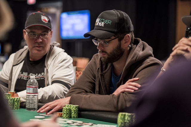 """Hoyt Corkins looks over at Caio Toledoq during the World Series of Poker's $1,500 buy-in """"Monster Stack"""" tournament held at the Rio Convention Center in Las Vegas on Tuesday, June 16, 20 ..."""