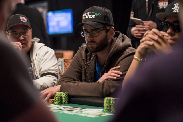 """Caio Toledoq looks at the dealer during the World Series of Poker's $1,500 buy-in """"Monster Stack"""" tournament held at the Rio Convention Center in Las Vegas on Tuesday, June 16, 2015. (Jo ..."""
