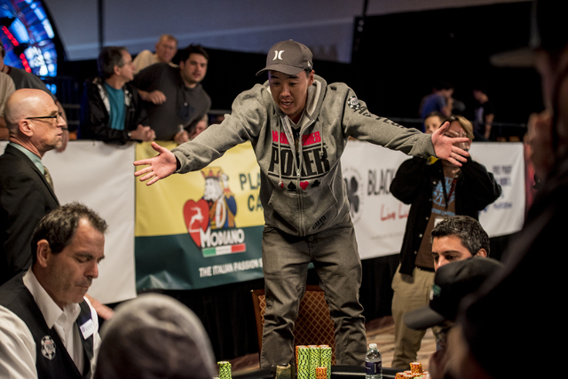 """Fernando Konishi stands on his chair after going all in during the World Series of Poker's $1,500 buy-in """"Monster Stack"""" tournament held at the Rio Convention Center in Las Vegas on Tues ..."""