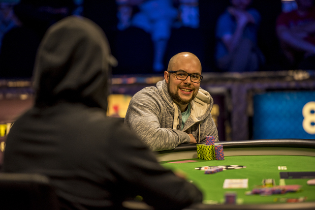 """Eric Place flashes a smile at Perry Shiao during the final table of the World Series of Poker's $1,500 buy-in """"Monster Stack"""" tournament held at the Rio Convention Center in Las Vegas on ..."""