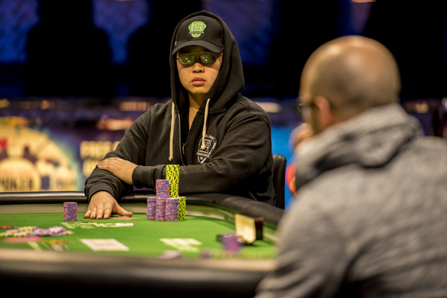 """Perry Shiao glances at Eric Place during the final table of the World Series of Poker's $1,500 buy-in """"Monster Stack"""" tournament held at the Rio Convention Center in Las Vegas on Wednesd ..."""