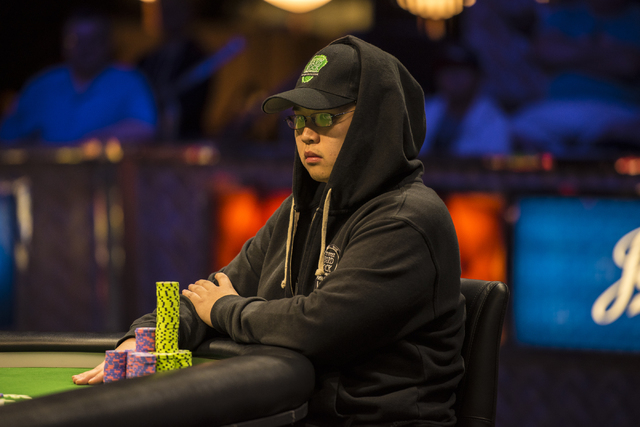"""Perry Shiao surveys the table during the final table of the World Series of Poker's $1,500 buy-in """"Monster Stack"""" tournament held at the Rio Convention Center in Las Vegas on Wednesday,  ..."""