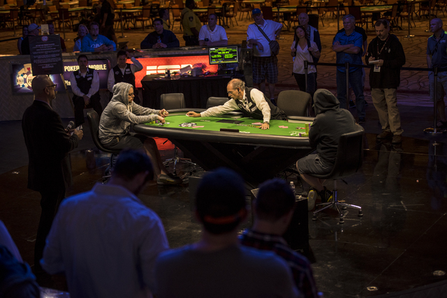 """Eric Place and Perry Shiao face off at the final table of the World Series of Poker's $1,500 buy-in """"Monster Stack"""" tournament held at the Rio Convention Center in Las Vegas on Wednesday ..."""